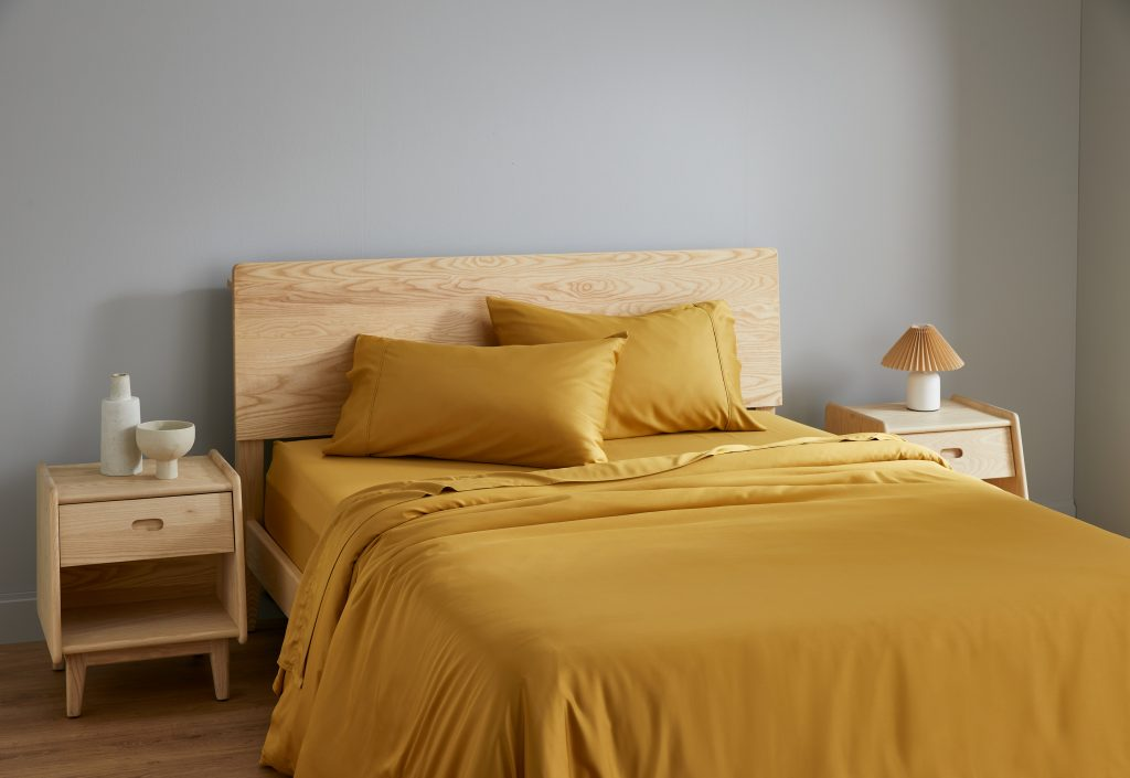 Bedroom styled with Ecosa mustard bamboo sheets.
