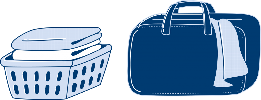 Linen sheets folded in a basket and stored in a suitcase.